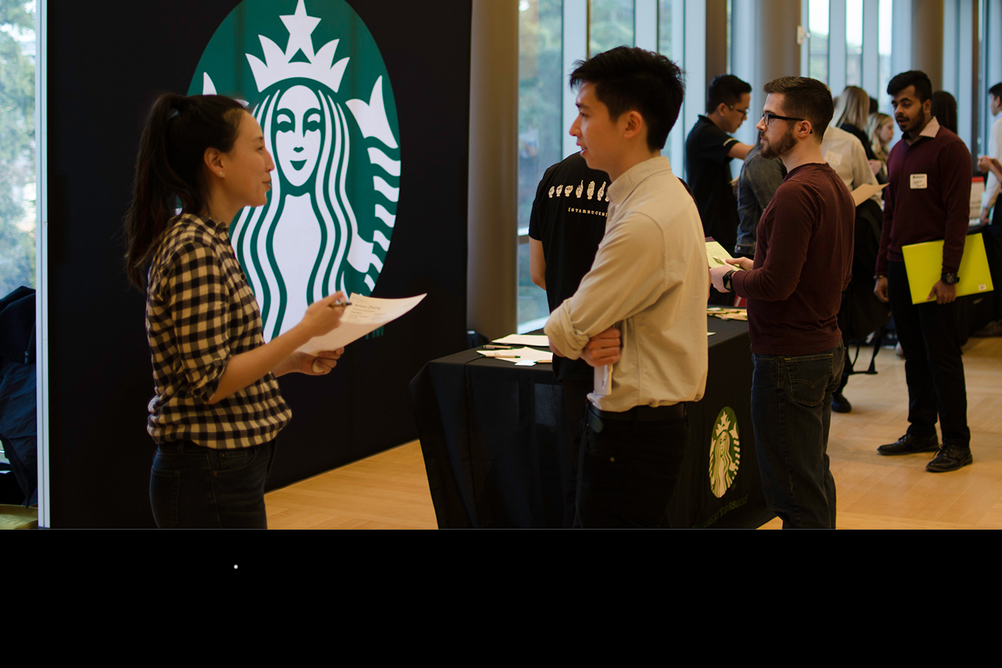 Starbucks representative and student at the iSchool Career Fair