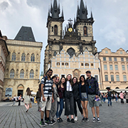 Students stand in front of a monument in Prague.