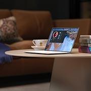 A laptop sitting on a desk.