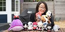 Jin Ha Lee, photographed with BTS memorabilia and her dog.