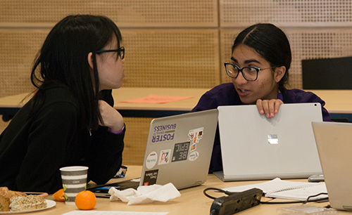 Linh Tran and Harkiran Saluja confer during the Hackathon.