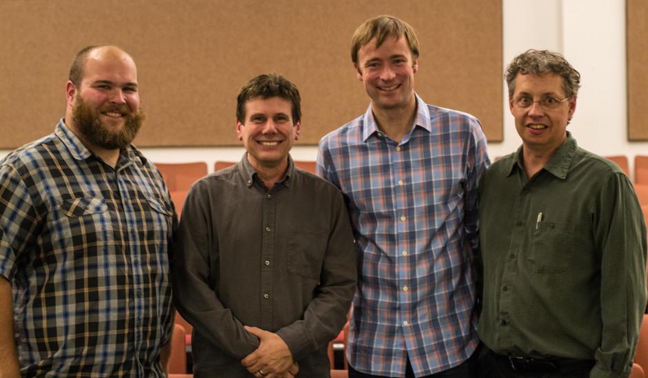 From left, Vinny Green and David Mikkelson of Snopes with Jevin West and Carl Bergstrom.