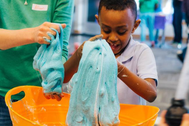 Kids wrangle slime at Read-a-Rama.
