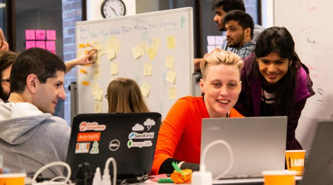 Hackathon participants brainstorm ideas for presentation