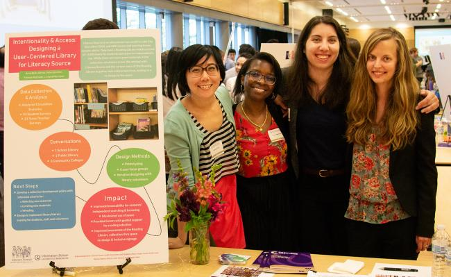 Four MLIS students at the 2019 Capstone event.