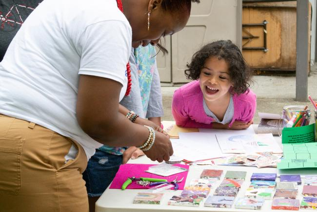 A child plays at a craft table during a 2019 Read-a-Rama camp in Seattle.