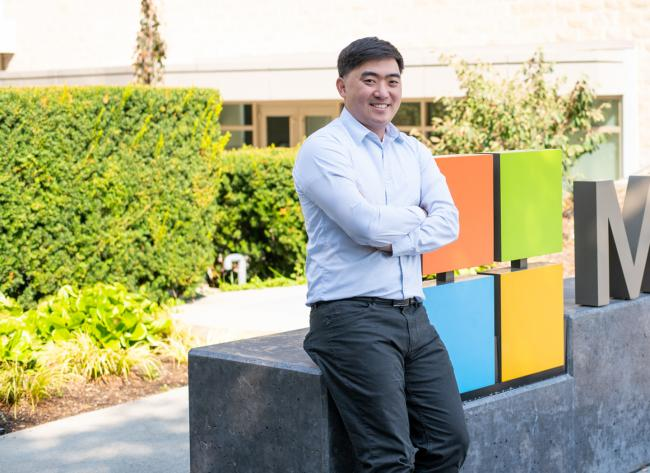 Andy Herman photographed next to a Microsoft sign on the company's Redmond campus.